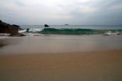 Sea, Beach, Ship on the horizon Stock Image
