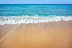 Sea beach. Soft wave of the sea on the sandy beach Stock Image