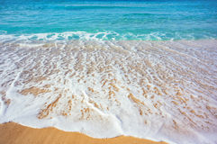 Sea beach. Soft wave of the sea on the sandy beach royalty free stock image