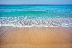 Sea beach. Soft wave of the sea on the sandy beach royalty free stock photography