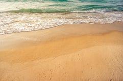 Sea beach. Soft wave of the sea on the sandy beach Stock Photos
