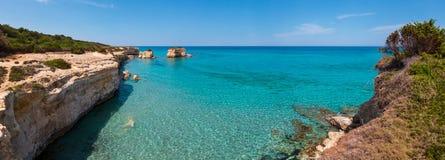 Sea beach Spiaggia della Punticeddha, Salento, Italy. Picturesque seascape with white rocky cliffs, sea bay, islets and faraglioni at beach Spiaggia della royalty free stock photo