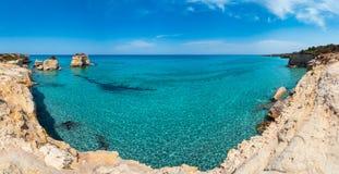 Sea beach Spiaggia della Punticeddha, Salento, Italy. Picturesque seascape with white rocky cliffs, sea bay, islets and faraglioni at beach Spiaggia della royalty free stock photography