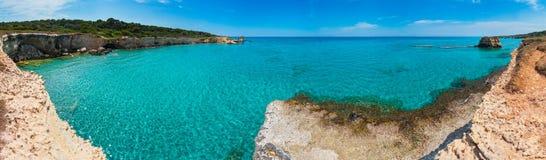 Sea beach Spiaggia della Punticeddha, Salento, Italy. Picturesque seascape with white rocky cliffs, sea bay, islets and faraglioni at beach Spiaggia della stock images