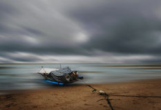 Sea and beach storm with fishing boat, Motion blur Stock Photography