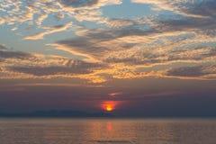 Sea beach sun set Stock Photos