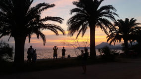 The sea beach with sunset and people watching Stock Photos