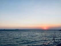Sea beach sunset stock photo