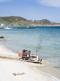 Sea beach with a tractor. Feodosia. Crimea Royalty Free Stock Photography