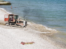 Sea beach with a tractor. Feodosia. Crimea Stock Photography