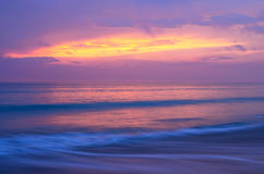 Sea beach at twilight, after sunset,multi color of sky and sea Stock Photos