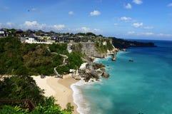 Sea and beach under blue sky Stock Image