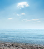 Sea beach under clouds Royalty Free Stock Photography