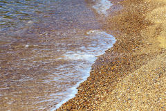 The sea beach with water, as nature background, warm tone Stock Photo