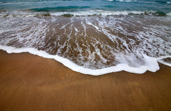 Sea beach with waves in dull day Royalty Free Stock Photography