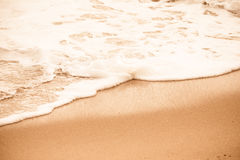 Sea beach in with white foam wave Stock Photography