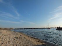Sea beach yacht. Yacht boat, pier and sand beach Royalty Free Stock Photos