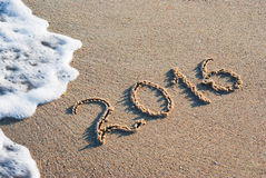 2016 a sea beach. Year 2016 written in sand on a sea beach Stock Photo