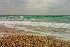 Sea in bead weather. On beach in bad weather Stock Images