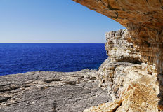 Sea behind a rock cave Royalty Free Stock Photo