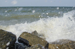 The sea with big rocks on the shore Stock Photos