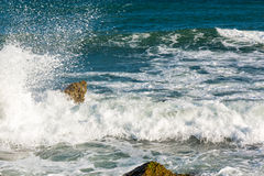Sea, big wave and splashes over the stones Royalty Free Stock Photography