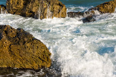 Sea, big wave and splashes over the stones Royalty Free Stock Photos