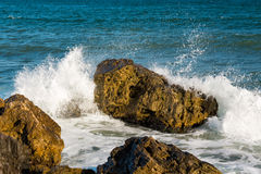Sea, big wave and splashes over the stones Stock Photo