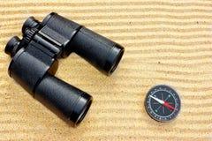 Sea Binoculars and Compass on Sand Stock Photography