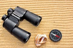 Sea Binoculars and Compass on Sand Royalty Free Stock Images