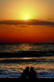 Sea birds at sunrise. Sunrise Romania Vama Veche beach in the summer with two silhouettes Royalty Free Stock Images