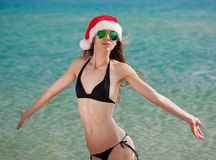 Sea. Black bikini sea, sunglasses, Christmas hat stock photo