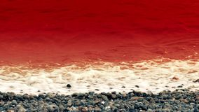 Sea Of Blood. Could be used as a metaphor for war, disasters, pollution, etc, or more literally for things like whales or dolphins being hunted