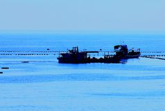 Sea. Blue sea fishing boat full normalization Royalty Free Stock Photo