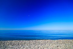 The deep blue sky of the sea shore stones.  stock images