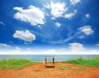 Sea blue sky with Alone Chair. Sea blue sky cloudy alone chair in the beach Stock Photo