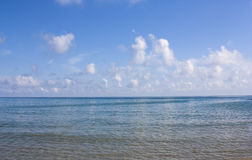 Sea and blue sky with clouds. Stock Photo