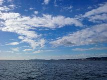 Sea and blue sky with clouds bay of Vigo, Spain royalty free stock images