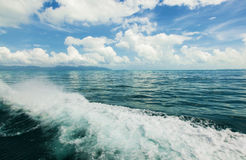 Sea and blue sky with clouds and sun Royalty Free Stock Photos