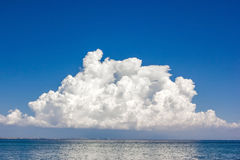 Sea and blue sky. With white clouds Stock Photography