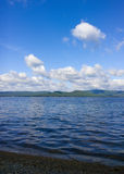 Sea and blue sky. White clouds over lake. Summer Landscape Stock Image