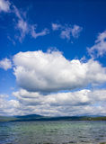 Sea and blue sky. White clouds over lake. Summer Landscape Royalty Free Stock Image