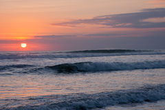 Sea with blue waves at sunset Royalty Free Stock Image