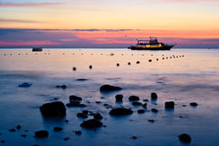 Sea and boat landscape at sunset time Royalty Free Stock Image