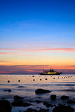 Sea and boat landscape at sunset time Royalty Free Stock Photography