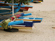 A sea boat on sand. Part of a typical balinese boat on the beach, Bali, Indonesia, November 2016 royalty free stock photo