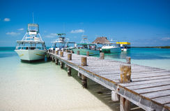 Sea boats at the Contoy island in the Caribbean sea Stock Image