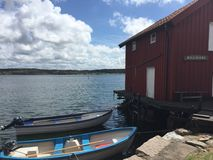 By the sea. Boats by fishing hut at Gullholmen Stock Photography