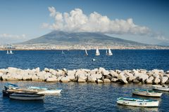 Sea and boats in Naples, Italy, on background volcano Vesuvius. Blue sea and boats in Naples, Italy, on background volcano Vesuvius stock image