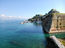 Sea, boats and the old fortress. In Corfu island Greece Stock Photo